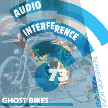 """Picture of a bike painted white with blue overlay reading """"Audio Interference 73: Ghost Bikes"""""""